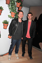 Left to right, DAMON ALBARN and RUFUS NORRIS at an after party following the first night of Dr Dee: An English Opera,  an opera created by theatre director Rufus Norris and musician and composer Damon Albarn held at St.Martin's Lane Hotel, St.Martin's Lane, London on 25th June 2012.