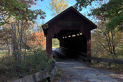 15 Oct 2011: Red covered bridge. Rural Indiana, Bean Blossom. This image was produced in part utilizing High Dynamic Range (HDR) or panoramic stitching or other computer software manipulation processes. It should not be used editorially without being listed as an illustration or with a disclaimer. It may or may not be an accurate representation of the scene as originally photographed and the finished image is the creation of the photographer.