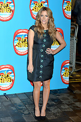 Caroline Flack arrives at the show.<br /> Celebrities attend the opening night of new West End show 'I Can't Sing' at The London palladium, London, UK. Wednesday, 26th March 2014. Picture by Ben Stevens / i-Images