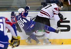 Andrej Hebar of Slovenia vs Sergejs Pecura of Latvia during ice-hockey match between Slovenia and Latvia of Group G in Relegation Round of IIHF 2011 World Championship Slovakia, on May 5, 2011 in Orange Arena, Bratislava, Slovakia. (Photo By Vid Ponikvar / Sportida.com)