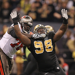Dec 27, 2009; New Orleans, LA, USA;  Tampa Bay Buccaneers guard Davin Joseph (75) blocks against New Orleans Saints defensive tackle Sedrick Ellis (98) during the first quarter at the Louisiana Superdome. Mandatory Credit: Derick E. Hingle-US PRESSWIRE..