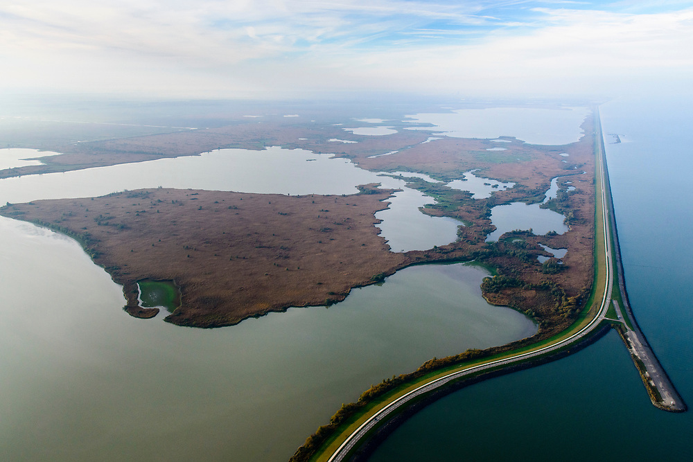 Nederland, Flevoland, Lelystad, 04-11-2018;  zicht op Oostvaardersplassen, Almere in het verschiet.<br /> View of lake area Oostvaardersplassen.<br /> <br /> luchtfoto (toeslag op standaard tarieven);<br /> aerial photo (additional fee required);<br /> copyright © foto/photo Siebe Swart