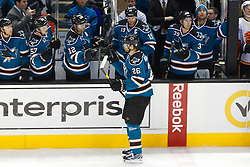 Jan 17, 2012; San Jose, CA, USA; San Jose Sharks center Michal Handzus (26) is congratulated by teammates after scoring a goal against the Calgary Flames during shootouts at HP Pavilion. San Jose defeated Calgary 2-1 in shootouts. Mandatory Credit: Jason O. Watson-US PRESSWIRE