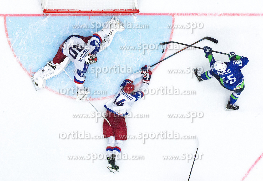 Robert Sabolic of Slovenia scores vs Viktor Tikhonov of Russia and Konstantin Barulin of Russia during Ice Hockey match between Russia and Slovenia at Day 3 in Group B of 2015 IIHF World Championship, on May 3, 2015 in CEZ Arena, Ostrava, Czech Republic. Photo by Vid Ponikvar / Sportida