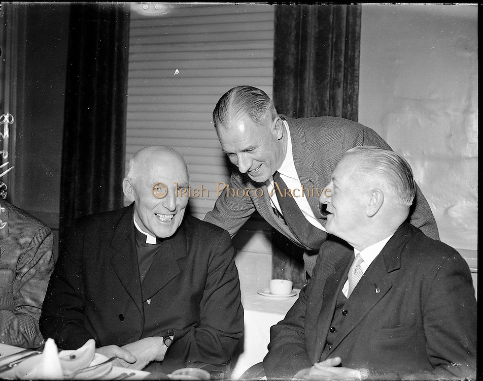 """Kerryman's Association Annual Dinner..1960..30.01.1960..01.30.1960..30th January 1960..The annual dinner of the Kerryman's Association held its annual dinner in the Dolphin Hotel, Dublin...Mr Paul Russell, (centre), Chairman, Dublin Kerryman's Association is pictured chatting with two of the principal guests at the dinner, Rev Fr T Walsh, St Saviours, Dominic Street,Dublin and Dr Eamon O""""Sullivan,Killarney, trainer of the Kerry team."""