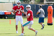 Miami Dolphins quarterback Jake Rudock (5) passes the ball while quarterback Josh Rosen (3) watches during Minicamp at the Baptist Health Training Facility at Nova Southeastern University, Tuesday, August 6, 2019, in Davie, Fla. (Kim Hukari/Image of Sport)