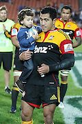 Mils Muliaina and his son Max during the post game presentation for his 100th game after the Investec Super 15 Rugby match, Chiefs v Stormers, at Waikato Stadium, Hamilton, New Zealand, Saturday 14 May 2011. Photo: Dion Mellow/photosport.co.nz