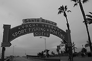 Black and white photo Santa Monica Sign wall art. The art deco Santa Monica, CA sign at the top of the Santa Monica Pier, sign is from 1941. Limited edition matted print. Fine art photography print.