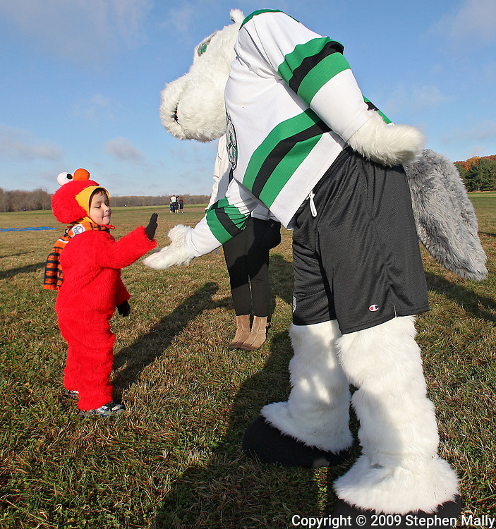 Joel Schmidt (from left), 4, of Dubuque greets RoughRiders mascot Ricochet at the Muddy Monster Cross Country Run at Seminole Valley Park in Cedar Rapids on Saturday October 24, 2009. Over 500 people were registered for the event which featured a 5K run/walk, a 15K run, a 1 mile run for kids 17 and under, and a kids fun run. Proceeds from the event benefit The Achilles Heel Foundation.