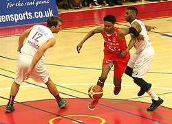 Bristol Flyers' Bree Perine takes on the Leeds defence - Photo mandatory by-line: Robbie Stephenson/JMP - Mobile: 07966 386802 - 18/04/2015 - SPORT - Basketball - Bristol - SGS Wise Campus - Bristol Flyers v Leeds Force - British Basketball League