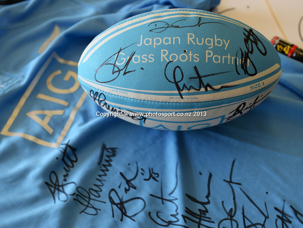 AIG branded rugby ball during a visit to Aoyama Elementary School ahead of the test match tomorrow between the New Zealand All Blacks and Japan. Rugby Union. Tokyo, Japan. Friday 1 November 2013. Photo: Andrew Cornaga/www.Photosport.co.nz