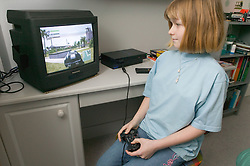 Girl playing a computer game in her bedroom,