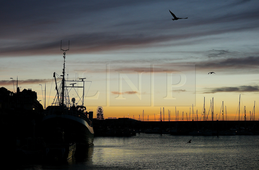 © Licensed to London News Pictures. <br /> 05/10/2014. <br /> <br /> Scarborough, United Kingdom<br /> <br /> Fishing boats are moored up in the harbour at Scarborough, North Yorkshire as dawn breaks over the north sea.<br /> <br /> Photo credit : Ian Forsyth/LNP