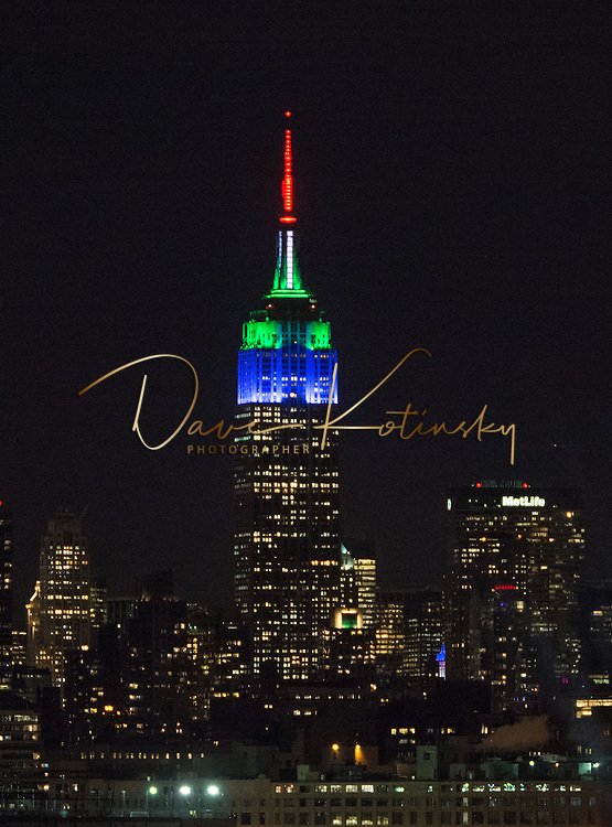 JERSEY CITY, NJ - JANUARY 27:  A view of the Empire State Building showcasing the colors of the two Super Bowl XLVIII teams at Liberty State Park on January 27, 2014 in Jersey City, New Jersey.  (Photo by Dave Kotinsky/WireImage)