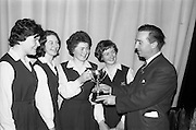 14/03/1964<br /> 03/14/1964<br /> 14 March 1964<br /> Leinster finals of Gael Linn Debating Competition for secondary schools at Manor House School, Raheny, Dublin. Four smart girls from Scoil Chaitriona, Eccles Street, Dublin who beat the boys and girls from Manor House School, Raheny, Co. Dublin; Good Counsel College, New Ross and Gormanstown College, Co. Meath. Picture shows Micheal O Ciosoig presebnying the trophy to (left to right) Isolda Ni Bhroin; Bernadate Ni Chorcoran; Nessa Ni Thuama and Brid Ni Shuilleabhain of Scoil Chaitriona.