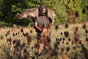 Scene of hunter in prehistoric times carrying a dead boar on his shoulders. Image taken from the filming of 'Paris la ville a remonter le temps' written by Carlo de Boutiny and Alain Zenou, directed by Xavier Lefebvre, a Gedeon Programmes production. Picture by Manuel Cohen