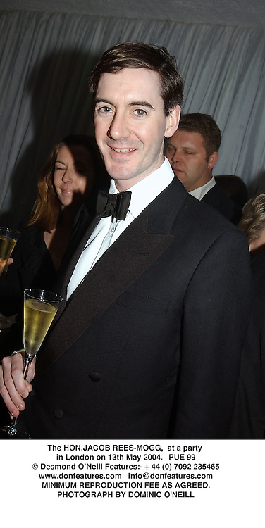 The HON.JACOB REES-MOGG,  at a party in London on 13th May 2004.PUE 99