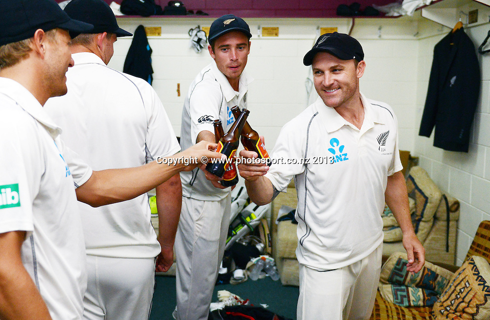 Brendon McCullum in the dressing room with team mates after a 2-0 series win over the West Indies on Day 4 of the 3rd cricket test match of the ANZ Test Series. New Zealand Black Caps v West Indies at Seddon Park in Hamilton. Sunday 22 December 2013. Photo: Andrew Cornaga / www.Photosport.co.nz