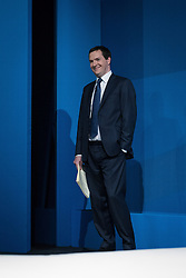 © Licensed to London News Pictures . 30/09/2013 . Manchester , UK . The British Chancellor of the Exchequer , GEORGE OSBORNE , waits to address the conference this afternoon (Monday 30th September 2013) . Day 2 of the Conservative Party Conference 2013 at Manchester Central . Photo credit : Joel Goodman/LNP