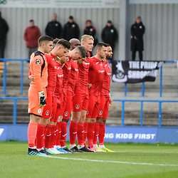 TELFORD COPYRIGHT MIKE SHERIDAN Telford players observe a minute's silence during the Vanarama National League Conference North fixture between Curzon Asthon and AFC Telford United on Saturday, November 9, 2019.<br /> <br /> Picture credit: Mike Sheridan/Ultrapress<br /> <br /> MS201920-028