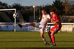 BANGOR, WALES - Monday, October 15, 2018: Wales' Neco Williams (R) an Poland's Luksz Norkowski (L) during the UEFA Under-19 International Friendly match between Wales and Poland at the VSM Bangor Stadium. (Pic by Paul Greenwood/Propaganda)