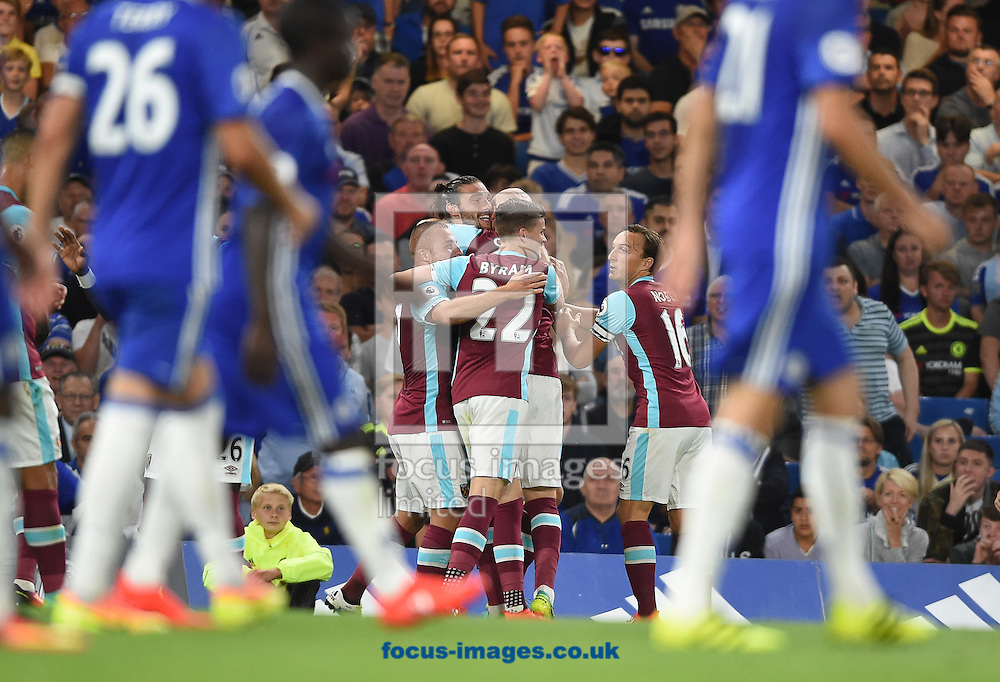 The players of West Ham United celebrate with goal scorer James Collins during the Premier League match at Stamford Bridge, London<br /> Picture by Daniel Hambury/Focus Images Ltd +44 7813 022858<br /> 15/08/2016