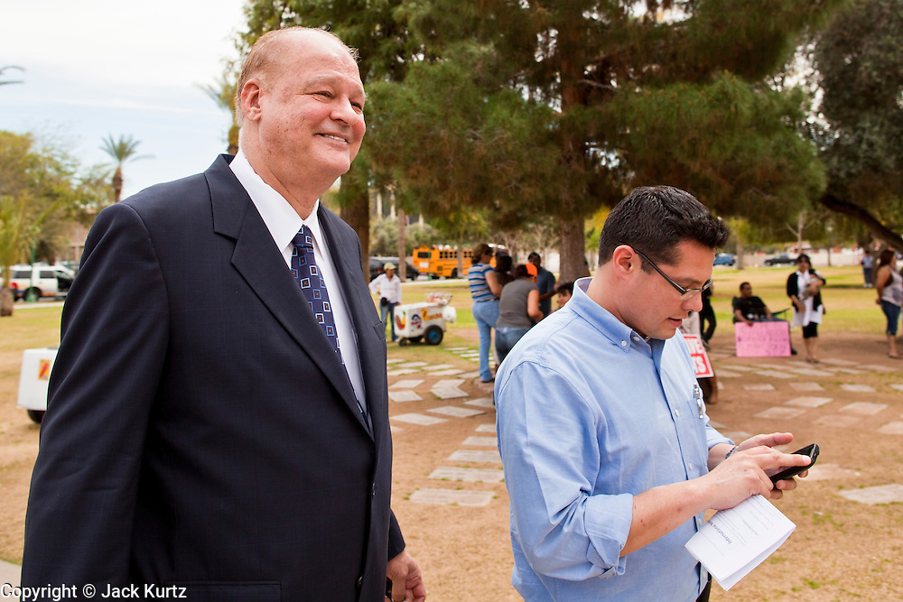 """14 MARCH 2011 - PHOENIX, AZ: TOM HORNE, Arizona's Republican Attorney General, walks across the plaza at the Arizona State Capitol in Phoenix Monday. Horne has supported toughening the state's anti-immigrant laws and eliminating """"ethnic studies"""" programs in the state's public schools. Protests by immigrants' rights activists have continued as the state's conservative Republican legislators debate toughening the state's anti-immigrant bills. Some of the bills the state legislature has debated this year include eliminating birthright citizenship, a law that would require hospitals to check the immigration status of patients checking in for elective care, a bill that would require schools to verify the immigration status of students when they enroll and a bill that would require law enforcement to impound the cars of undocumented immigrants even if they have a legal driver's license from another state.      Photo by Jack Kurtz"""