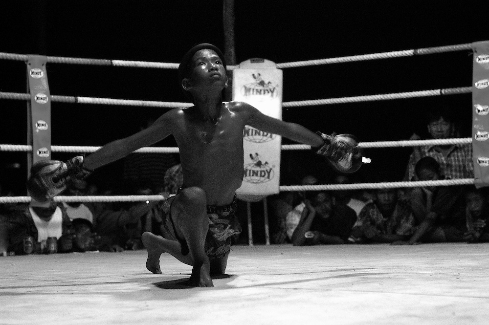 No matter what the age, Muay Thai fighters are expected to give their all. Muay Thai/Thai Boxing. The fighters go through a ritual ceremony before each bout..Bangkok Thailand March 2003 .©David Dare Parker/AsiaWorks Photography