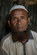 Zahir Ahmad (56) He lost his 15 family members, wife, sons, daughters, grandson and son-in-law. He is a survivor of the Tula Toli (Min Gyi village) massacre in Myanmar inside a make-shift shelter at the Balukhali refugee camp at Cox's Bazar District, Bangladesh - Photograph by David Dare Parker