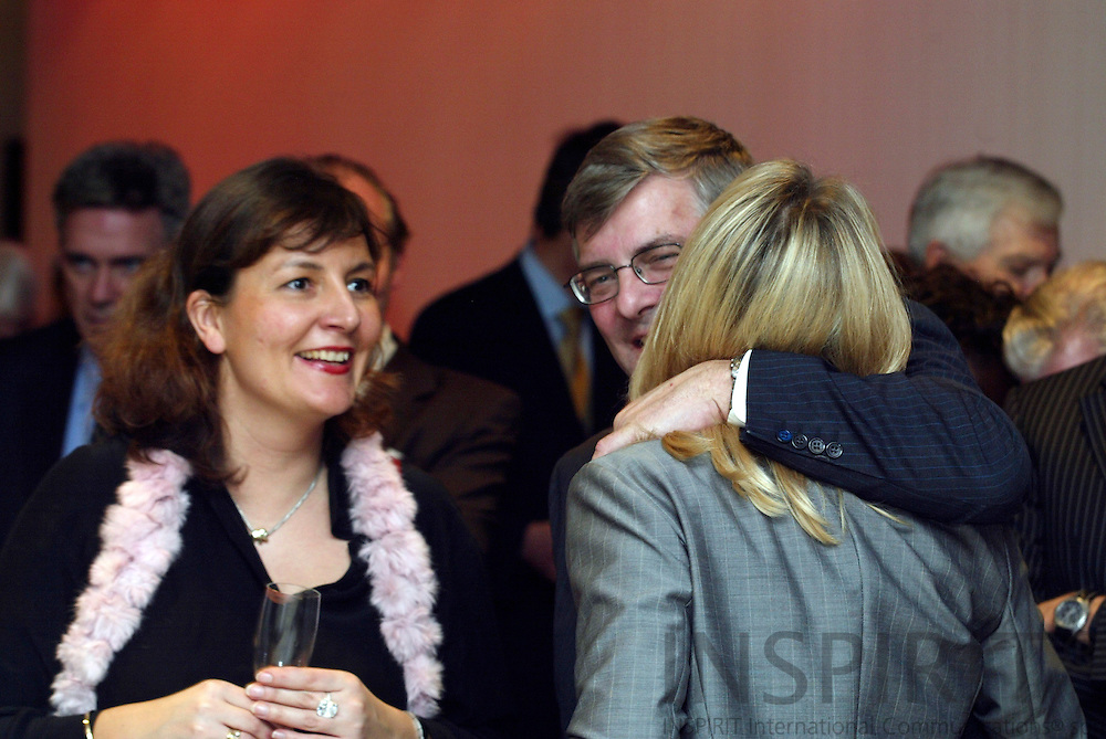 BRUSSELS - BELGIUM - 12 JANUARY 2006 --  Opening of Radisson SAS EU-Hotel. Charlotte ANDSAGER, Vice-President European and Public Affairs, get a hug from Jørgen (Jorgen, Joergen) LINDEGAARD, President and CEO of the SAS group, after her speech while a unknown lady looks happy.  PHOTO: ERIK LUNTANG /