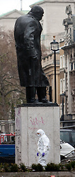 © Under license to London News pictures. 10/12/2010 A Forensic team collecting evidence underneath a staue of Winston Churchill in parliament square today (10/12/2010) following student demonstrations. Students clashed with police and vandalised memorials and bulildings in parliament square around Westminster. Photo credit should read Fuat Akyuz/London News Pictures...