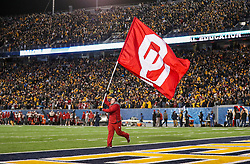 Nov 23, 2018; Morgantown, WV, USA; An Oklahoma Sooners cheerleader waves a flag during the fourth quarter against the West Virginia Mountaineers at Mountaineer Field at Milan Puskar Stadium. Mandatory Credit: Ben Queen-USA TODAY Sports