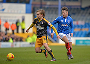 Cambridge United Midfielder Luke Berry holds off Portsmouth striker Marc McNulty during the Sky Bet League 2 match between Portsmouth and Cambridge United at Fratton Park, Portsmouth, England on 27 February 2016. Photo by Adam Rivers.