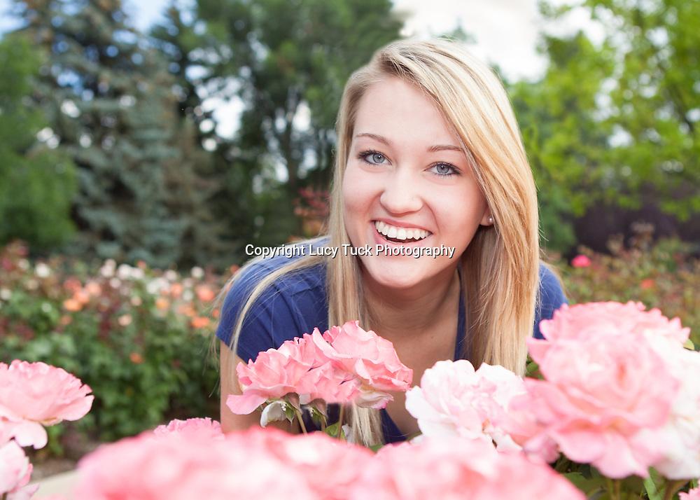High School Senior Portrait in a flower garden
