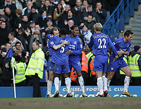 Photo: Lee Earle.<br /> Chelsea v Portsmouth. The Barclays Premiership. 25/02/2006. Chelsea's Arjen Robben (L) is congratulated after he scored their second goal.