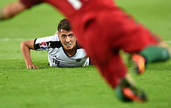 Alessandro Schopf of Austria watches the ball from the ground  - Mandatory by-line: Joe Meredith/JMP - 18/06/2016 - FOOTBALL - Parc des Princes - Paris, France - Portugal v Austria - UEFA European Championship Group F