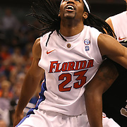 Florida Gators forward Alex Tyus (23) plays against the University of Central Florida Knights  at the Amway Center on December 1, 2010 in Orlando, Florida. Central Florida won the game 57-54 for their first ever victory against a nationally ranked team. (AP Photo/Alex Menendez)