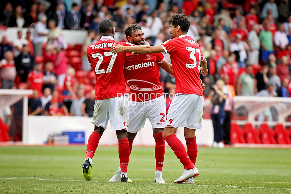 Nottingham Forest forward Hillal Soudani (2) Nottingham Forest defender Tendayi Darikwa (27)  and Nottingham Forest forward Gil Dias (31) celebrate after the EFL Sky Bet Championship match between Nottingham Forest and Reading at the City Ground, Nottingham, England on 11 August 2018.