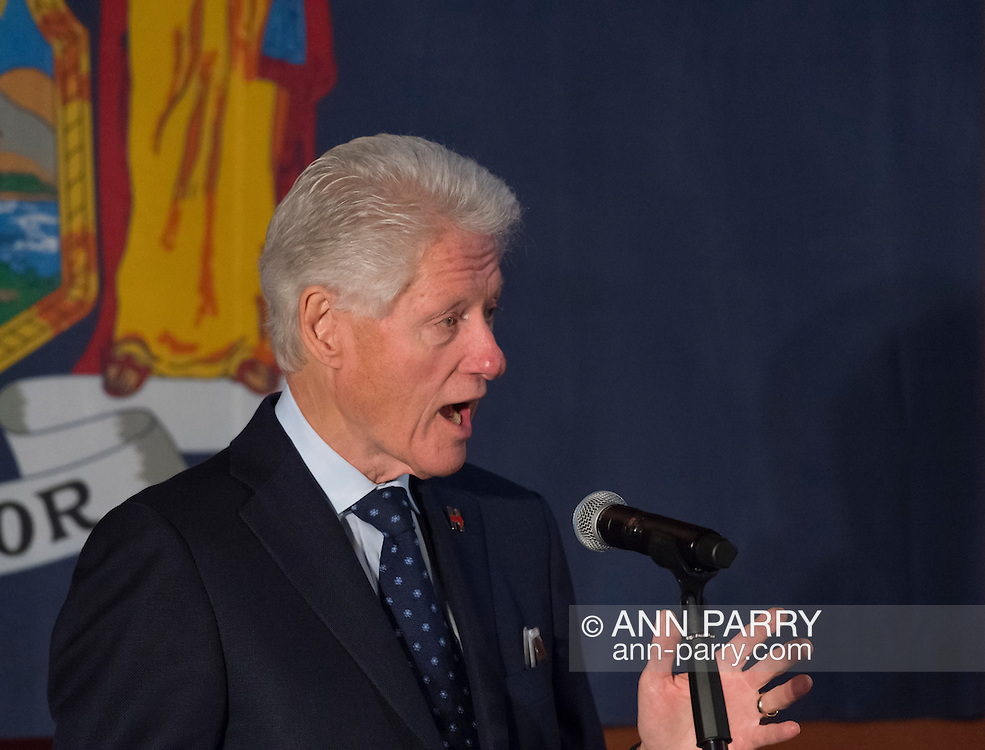 Former President Bill Clinton, giving a speech, is the headline speaker as he campaigns at an Organizing Event rally in Elmont, Long Island, on behalf of his wife, Hillary Clinton, the leading Democratic presidential candidate, and former Secretary of State and U.S. Senator for New York. Podium has 'Fighting for us' slogan on sign. The New York Democratic Primary takes place April 19th.