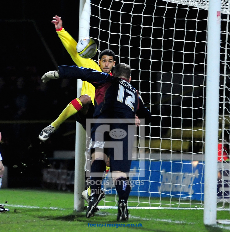 London - Tuesday, January 27th, 2009: Jobi McAnuff of Watford scores the first goal past a helpless Brian Jensen of Burnley during the Coca Cola Championship match at Vicarage Road, London. (Pic by Daniel Hambury/Focus Images)