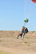 Israel, Habonim Skydive centre Tandem jumpers approach the ground for landing