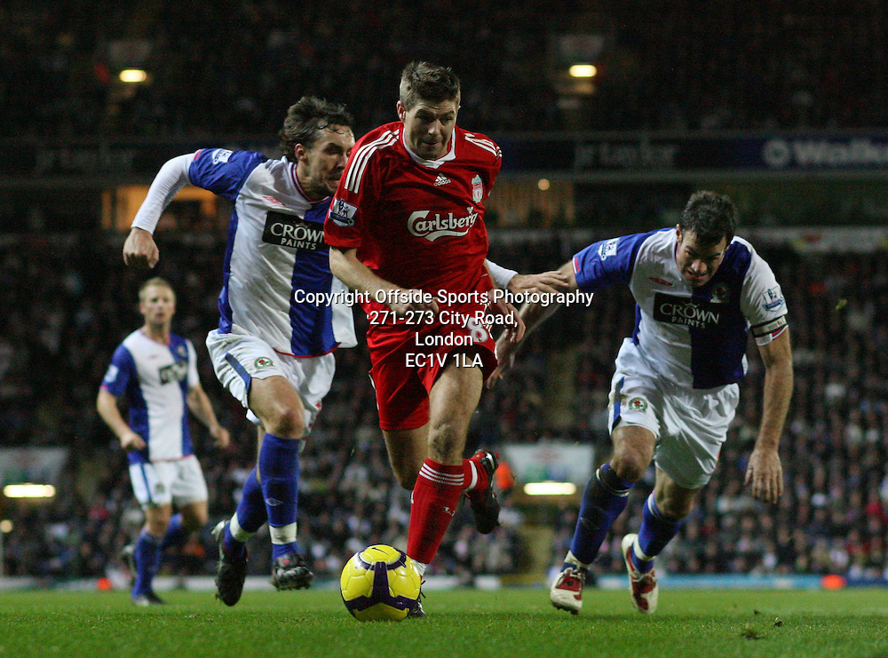 05/12/2009 - Barclays Premier League - Blackburn Rovers vs. Liverpool - Gael Givet (L) and Ryan Nelsen (R) of Blackburn battle with Steven Gerrard of Liverpool - Photo: Simon Stacpoole / Offside.