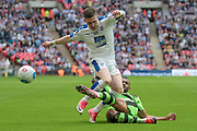 Jack Dunn (Tranmere Rovers) is tackled by Dan Wishart (Forest Green Rovers) during the Vanarama National League Play Off Final match between Tranmere Rovers and Forest Green Rovers at Wembley Stadium, London, England on 14 May 2017. Photo by Mark P Doherty.