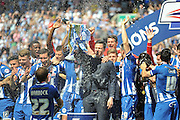 Wigan lift the League One trophy after the Sky Bet League 1 match between Wigan Athletic and Barnsley at the DW Stadium, Wigan, England on 8 May 2016. Photo by John Marfleet.