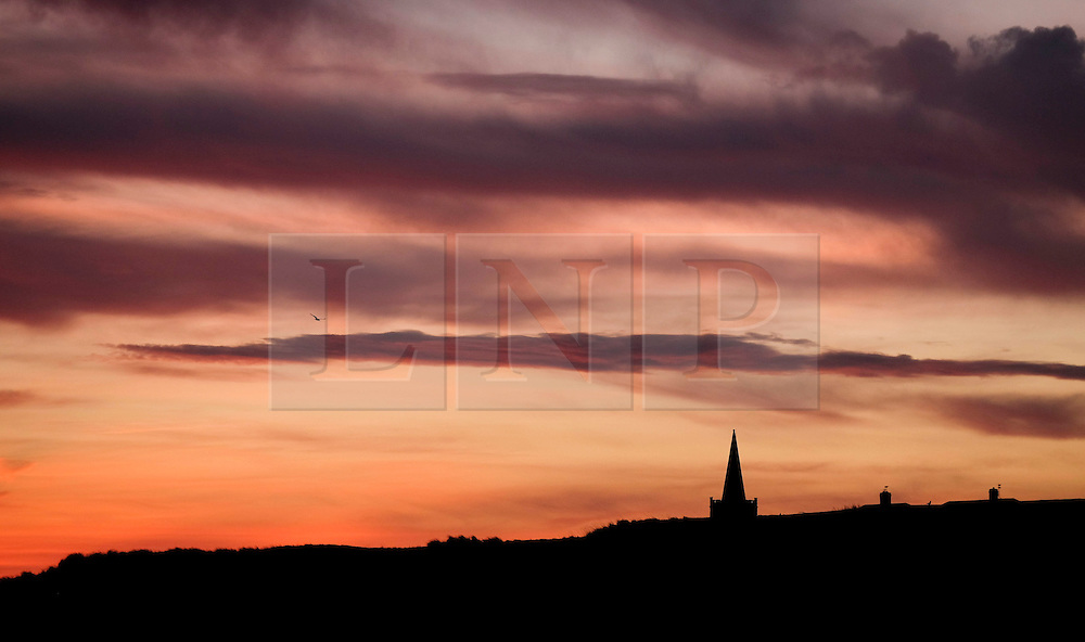 © Licensed to London News Pictures. 25/01/16<br /> Marske-by-the-Sea, UK. <br /> <br /> Early morning clouds over Marske by the Sea are dramatically lit by the sunrise.<br /> Remnants of Storm Jonah are expected to bring weather disruption to parts of the country over the next few days.<br /> <br /> Photo credit : Ian Forsyth/LNP