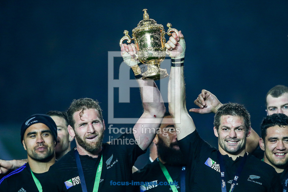 Richie McCaw of New Zealand (right) holds the Rugby World Cup trophy aloft after the final of the 2015 Rugby World Cup at Twickenham Stadium, Twickenham<br /> Picture by Andy Kearns/Focus Images Ltd 0781 864 4264<br /> 31/10/2015