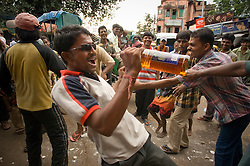 Kolkata's (Calcutta) rickshaw pullers relax and some dance after the holiday for the God of Industry Viswa Karma Puja September 18, 2007 next to the Kali Temple in Southern Kolkata.