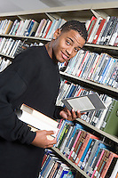 Male University student in library, portrait