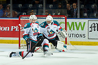 KELOWNA, CANADA - JANUARY 16:  Kaedan Korczak #6 tries to block a shot on James Porter #1 of the Kelowna Rockets during third period against the Moose Jaw Warriors on January 16, 2019 at Prospera Place in Kelowna, British Columbia, Canada.  (Photo by Marissa Baecker/Shoot the Breeze)