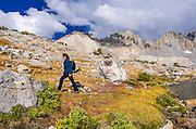 Hiker under the Palisades in Dusy Basin, Kings Canyon National Park, California USA